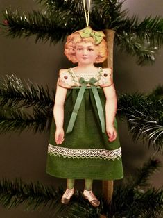 Handmade Victorian paper doll ornament wearing a green moire dress trimmed with vintage lace. Made by NeedleandThreadLLC on etsy. Christmas In Europe, Christmas Love, Christmas Crafts, Christmas Wreaths, Beaded Christmas Ornaments, Vintage Ornaments, Victorian Paper Dolls, Decoupage, Victorian Christmas