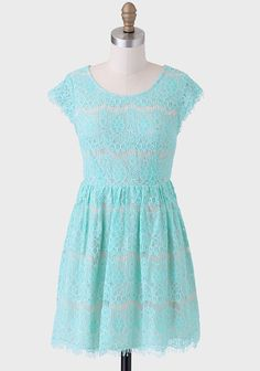 We're swooning over this vibrant mint fit-and-flare dress featuring a beige-hued slip and gathered waistline. Finished with a raw-edged hemline, sheer cap sleeves, and a V-cutout back, this...