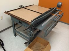 A new board shear and book presses for the University of Baltimore Book Arts Studio!