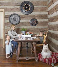Hung on a wall in this Tennessee log cabin, wooden foundry molds double as striking art.