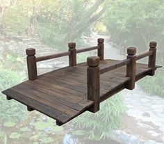 Add a spot of tranquility to your garden with this Wooden Garden Bridge. Classic arch design made from treated timber fir wood, this cute little bridge has a wooden plank design with stumpy miniature rails.