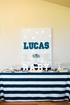 Stunning navy and gold dessert table at a baby shower! See more party planning ideas at CatchMyParty.com!