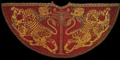 "A coronation robe worn by Roger II, King of Sicily (1093-1154) and later also used by Frederick II of Hohenstaufen, Holy Roman Emperor (1194-1250) is on display at the Weltliche-Schatzkammer, Vienna. Idries Shah explains its symbolism: In the center stands a palm tree, containing the nine elements of the ""magic square of fifteen,"" attributed to Geber (Jabir) the Sufi reverenced alike by the Latin alchemists and the Chinese Taoists. The palm tree (in Arabic: NaKHL) is chosen because the…"