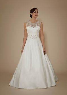 #plussize #plussizebrides #bridalgowns | Sleeveless Plus Size Wedding Gown with sheer illusion neckline |  Aline Wedding Dresses for Plus Size Women | www.dariuscordell.com/featured/plus-size-wedding-dresses-bridal-gowns/