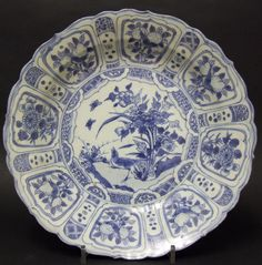 A Ming Hatcher Cargo Kraak Porcelain Dish, c.1643. The Barbed Rim Shallow Porcelain Dish has Typical Kraak Border Panels of Flowers, Fruit and Birds. The Center Decorated with a Bird on a Rock with Peony and Two Butterflies. Christie's Hatcher Auction Label on the base.