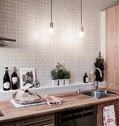 Kitchen | light grey mosaic and wood