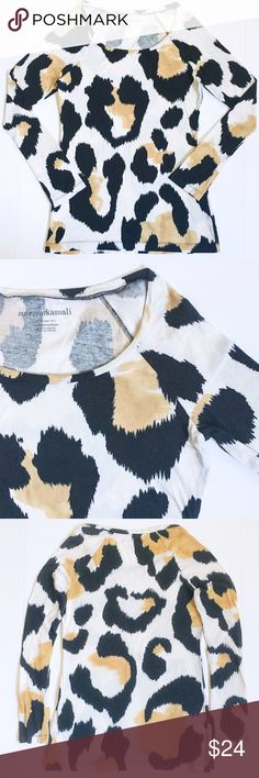 NormaKamali 100% Organic Cotton Animal Print Shirt Fabulous animal print long sleeved tee from Designer, Norma Kamali. Made from soft, luxurious and eco-friendly 100% organic cotton! This beautiful long sleeve shirt is preloved GUC, with no apparent flaws and lots of life left! Norma Kamali Tops Tees - Long Sleeve