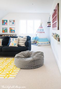 Colorful Playroom of The Lilypad Cottage.  Reading tent, vibrant pillows, playful rug