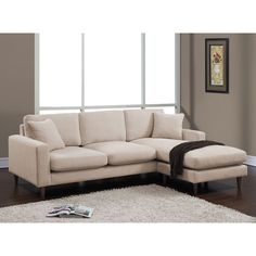 Lounge in total comfort with the Shaffer two-piece sectional made with soft cushions and plush--with foam surrounded by down, poly fill and poly fiber. The espresso-finished solid wood legs are a perfect complement to buff linen-like fabric upholstery.