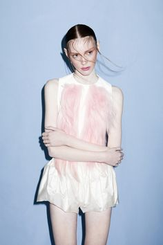 42 CONCEPT colour palette (whites clothes, pale blue background) lo contrast, sharp shadow on background.