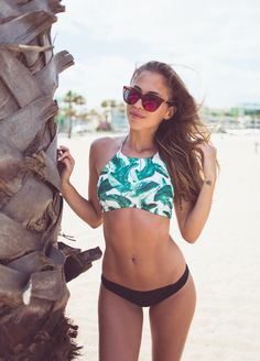 Kenza Zouiten takes to the beach in an H&M bikini top with banana leaf print. | H&M OOTD