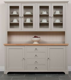 The Parsonage Dresser from the Kitchen Dresser is shown painted in plover gray; prices start at £2,610.