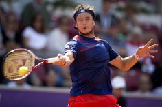 Argentinian tennis player Juan Monaco plays against Bulgarian Grigor Dimitrov during Swedish Open tennis tournament on July 12, 2013 in Bastad, Sweden