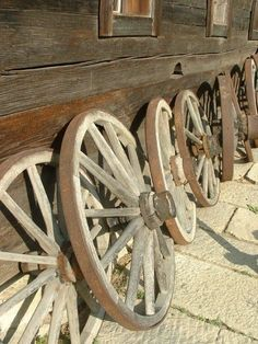 Wagon wheels on pinterest wagon wheels old wagons and for Things to do with old wagon wheels
