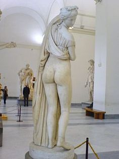 """The Venus Kallipygos or Aphrodite Kallipygos (Greek: Ἀφροδίτη Καλλίπυγος), also known as the Callipygian Venus, all literally meaning """"Venus (or Aphrodite) of the beautiful buttocks"""",[1] is an Ancient Roman marble statue, thought to be a copy of an older Greek original."""