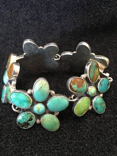 "Artist: Federico Jimenez Turquoise Sterling Silver Solid Back Size: 7 Signed By Federico Jimenez $425- Federico Federico Jimenez, originally from the tiny village of Tututepec, Mexico resides in Southern California where he has been collecting and making jewelry for many years. Today he is a world renowned authority on Mexican silver, Pre-Columbian and Mixtec (pronounced ""Mishtek"") jewelry. He became interested in Meso-American art in his late teens when he and his father uncovered a…"