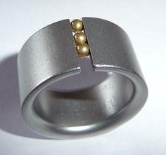 """Original Niessing ring """"Abakus"""": steel with moving 18 K gold balls"""