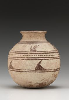 Water birds ring this Iranian earthenware jar, dating to the Late Bronze Age. | Jar | ca.2400-1400 B.C.E. | Late Bronze Age | Earthenware with paint | Iran | Gift of Osborne and Gratia Hauge | Arthur M. Sackler Gallery | S1998.21