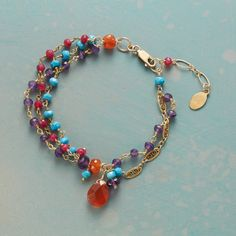 CARNELIAN AND COMPANY BRACELET -- Carnelian hangs halfway between three strands on one side, two on the other. Filigree links and golden twists spark amethysts, turquoise and rubies. Handcrafted exclusive. 14kt gold filled