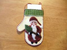 Needle Felted Santa Holding a Tree on Wool Felt Mitten by Sita802, $10.00 #handmadebot #boebot