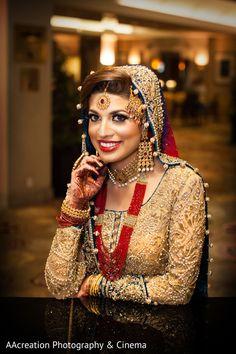Bride wearing bridal lehenga and jewelry. #IndianBridalHairstyle #IndianBridalMakeup #IndianBridalFashion #BridalPhotoShoot