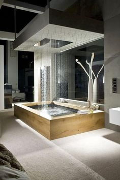 A full rain shower doubles as a tub feature, completely open to this room. The mirror behind the tub helps to make the space - and the shower - seem much larger than it is.