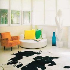 love this color combo with the cow hide rug thrown in