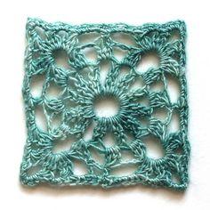granny square crocheted with jill draper's aurora lace yarn.