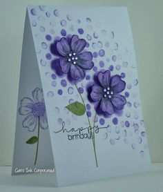 Follow the tutorial to create this great background using the Bo Keh technique. It involved water-based inks and a water brush to make the background flow around the popped up dimensional flower. Love the purple/lavendar colors!