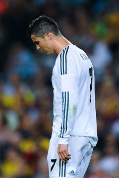 Cristiano Ronaldo of Real Madrid looks dejected after missing a chance to score during the La Liga match between FC Barcelona and Real Madrid CF at Camp Nou on October 26, 2013 in Barcelona, Catalonia.