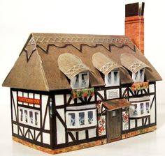 UK Paper English Village series - print, fold. build up. This one is 5 3/8 long, 3 1/2 wide and 5 1/8 high chimney
