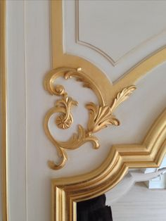 Detail of HAND CARVED solid wood authentic Boiserie dining room by Auffrance. Shown in metal gold leaf. Auffrance.com