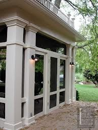 around a hackberry tree :: Havens South Designs :: loves the lights on columns of this Nashville screened porch with triple door set:: Havens South Designs :: loves the lights on columns of this Nashville screened porch with triple door set Back Porches, Decks And Porches, Back Patio, Screened Porch Designs, Screened In Porch, Front Porch, Outdoor Rooms, Outdoor Living, Outdoor Life