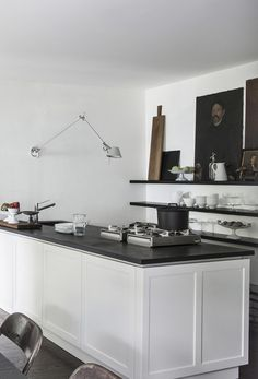 Monochrome kitchen with open shelving