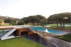 Casa Vale Do Lobo was completed by the Portuguese studio Arqui+. This 6,450 square foot contemporary residence has been developed in a U shape around a central courtyard. A suspended pool forms the main focal point of the villa.