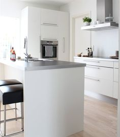 Love the plant pots on top of the extractor fan |  Tonje's kitchen in Norway | Minimalist | live from IKEA FAMILY