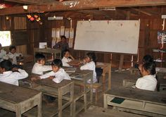 UWS  classroom by Flickr user Charles Pieters.  United World Schools (UWS) is a NGO that helps to build schools in remoted areas in Ratanakiri. The villagers themselves make the construction. www.unitedworldschools.org/