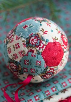 Very cute ornament using scraps of fabric poked into Styrofoam.  No glue needed.