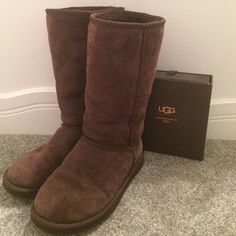 Chocolate Brown Ugg Boots Dark brown ugg boots. Only flaw is small scratch in right shoe as shown in third picture. Normal wear like creasing where the foot bends but still in excellent condition. 100% authentic, purchased in 2009. Size 6 but definitely could fit 6.5. Care Kit is not included! UGG Shoes Winter & Rain Boots