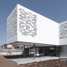 The façade of this house in Valencia by Spanish architects BBLab Arquitectos is punctured with a pattern of circular holes.