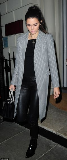 Dressed up: Kendall, 19, opted for a smart pinstriped blazer over a black top and waxed skinny jeans