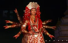 Dancers dressed as Kumari, The Living Goddess, perform a traditional dance in Kathmandu, Nepal in this June 13, 2009 picture.