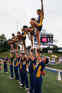 The cheerleaders warming up on the sideline before the game with Northwestern