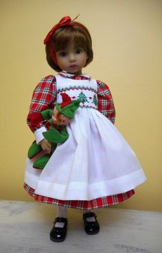 """Smocked in tiny Christmas trees and trimmed in piping, lace and satin trim for Effner 13"""" doll."""