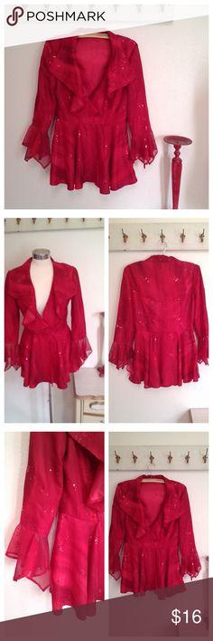 "Red Sheer ruffled jacket with sparkles Cute Red Jacket  Long sleeves with ruffled cuffs Ruffles at front Closes with hook and eye Shiny red poly fabric covered with metallic red dots like sequins  Perfect pirate jacket, Aarrr  No label  Measurements:  36"" bust 28"" Waist 27"" Length  Condition:  Hey good.  A few sparkles missing Jackets & Coats"