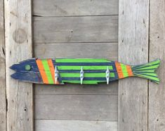 Unique hand painted wooden fish with three attached boat cleat hangers.Whimsical yet practical nautical decor. Art with a purpose.