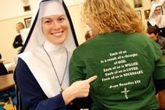 A joyful sister delights in the message given by a friend's t-shirt. Sisters of Mary, Mother of the Church | Spokane, WA