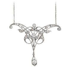 Edwardian 2.5 Carats Diamond Platinum Pendant. Edwardian/Art Nouveau filigree platinum pendant has 2.5 carats of old mine-cut diamonds in a graceful, lively setting. 14k white gold chain is attached. United States, circa 1900-1910