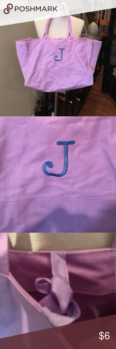 "Tote bag in Lilac w/ blue,""J"" initial monogrammed This tote bag is 17 inches wide and 11 inches high. It fastens w/ a tie on top. Unknown Bags Totes"