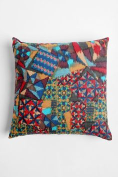 Magical Thinking Ikat Pillow - I recommend you use this type of thing in moderation, otherwise it could look tacky.